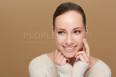Buy stock photo Cropped view of a pretty young woman touching her face