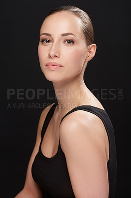 Buy stock photo Portrait of a beautiful woman with a black background