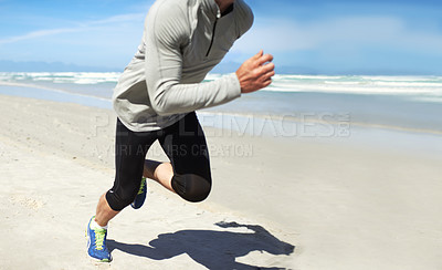 Buy stock photo Cropped shot of a man running along the beach