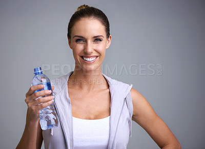 Buy stock photo Portrait of an attractive young woman holding a bottle of water