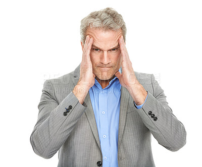 Buy stock photo Studio shot of a mature business man looking in pain