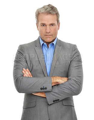 Buy stock photo A mature businessman looking at the camera with a serious expression