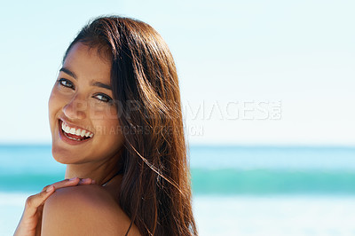 Buy stock photo A pretty woman looking over her shoulder on the beach
