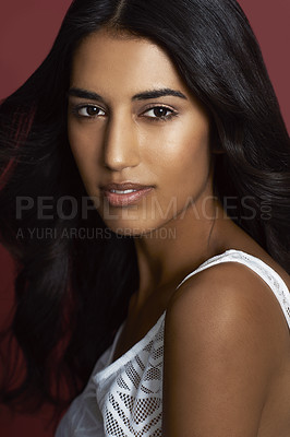 Buy stock photo Closeup portrait of a beautiful indian woman against a red background
