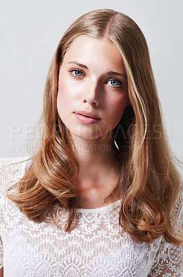 Buy stock photo Cropped portrait of an attractive young woman in the studio