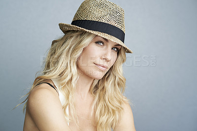 Buy stock photo A beautiful young woman wearing a summer hat posing in studio