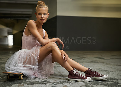 Buy stock photo A beautiful ballerina sitting on a skateboard wearing sneakers