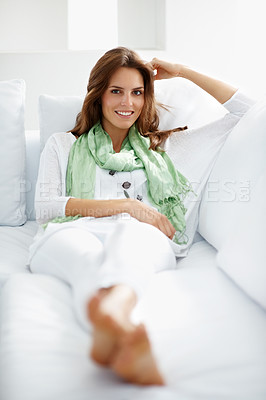Buy stock photo Lovely young woman relaxing on the couch