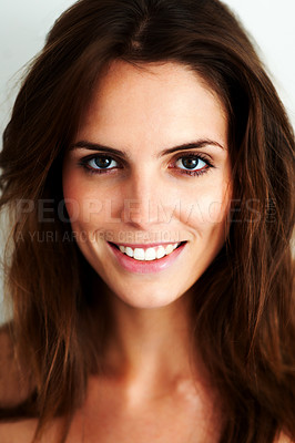 Buy stock photo Closeup portrait of an attractive young woman smiling at the camera
