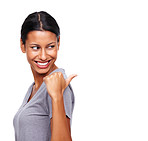 Young female pointing at blank space behind her
