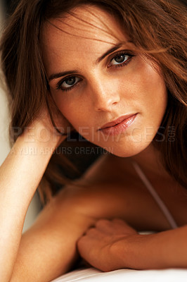 Buy stock photo Portrait of a beautiful young woman gazing alluringly at the camera - copyspace