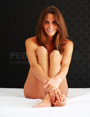 Buy stock photo Happy young naked female sitting on the bed