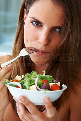 Buy stock photo Be vegetarian - Beautiful young woman eating fruit