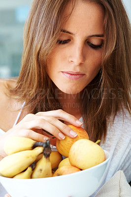 Buy stock photo Cute young female holding a bowl of fruits