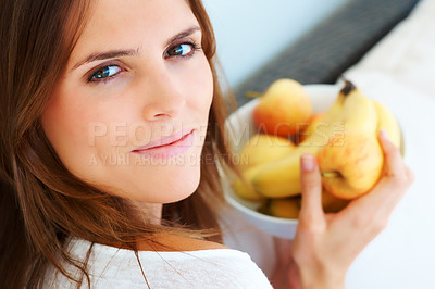 Buy stock photo Closeup of beautiful young woman holding fruit bow