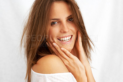 Buy stock photo Beautiful young female with her hand on cheek