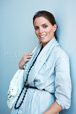 Buy stock photo Beautiful young woman standing with her handbag