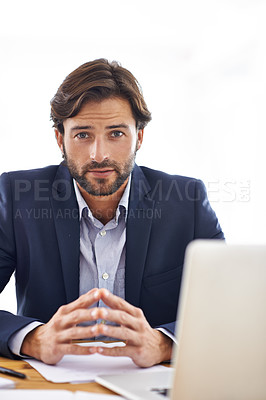 Buy stock photo A handsome businessman  sitting at his desk and working on his laptop