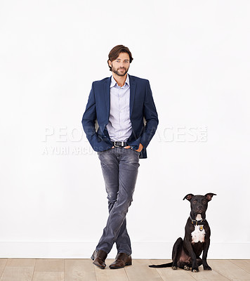 Buy stock photo A handsome man standing next to his dog - portrait