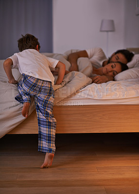 Buy stock photo Cropped shot of a young family in bed together