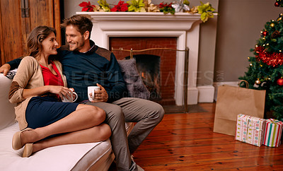 Buy stock photo A young couple relaxing at home during Christmas eve