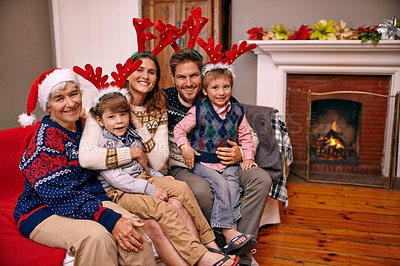 Buy stock photo Portrait of a happy family sitting together on Christmas eve