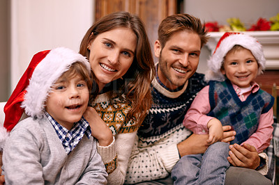 Buy stock photo Shot of a family enjoying themselves at Christmas