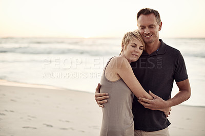 Buy stock photo Shot of a mature couple enjoying a day at the beach