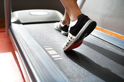 Buy stock photo Closeup shot of a man on a treadmill at the gym