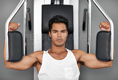Buy stock photo Shot of an athletic young man working out