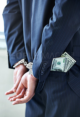 Buy stock photo Cropped shot of a businessman in handcuffs with money in his pocket