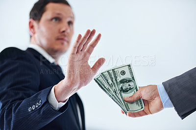 Buy stock photo Cropped shot of a businessman refusing a bribe