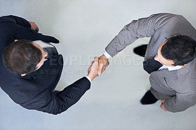 Buy stock photo High angle view of two businessmen shaking hands