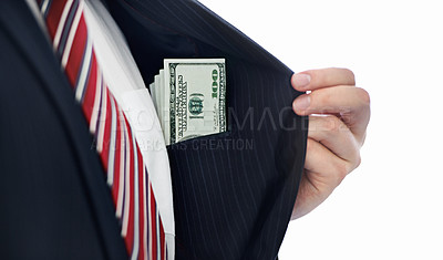 Buy stock photo A businessman showing money that's in his pocket