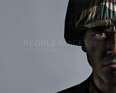 Buy stock photo Headshot of a serious military man with his face camouflaged