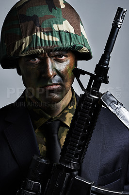 Buy stock photo A young military man wearing camouflage facepaint