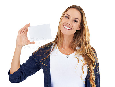 Buy stock photo Studio shot of a young woman carrying a blank placard isolated on white