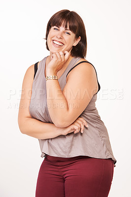 Buy stock photo Portrait of a happy young woman laughing on a white background