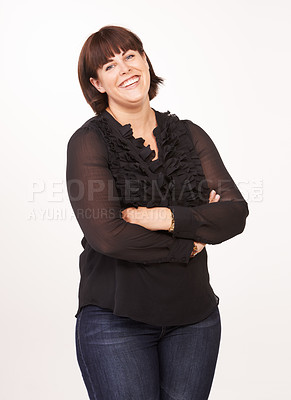 Buy stock photo Portrait of a pretty and curvy woman on a white background