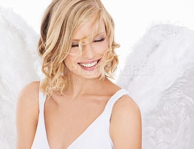 Buy stock photo Studio shot of a beautiful young woman wearing angel wings