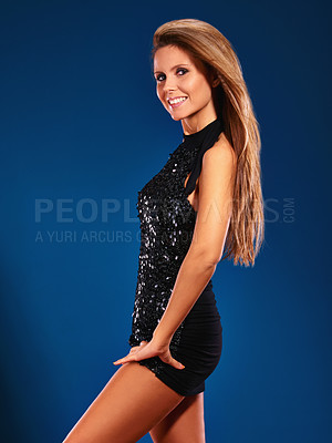 Buy stock photo A young woman posing in a sparkly black mini dress
