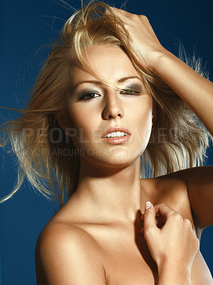 Buy stock photo An attractive young woman looking with allure at the camera