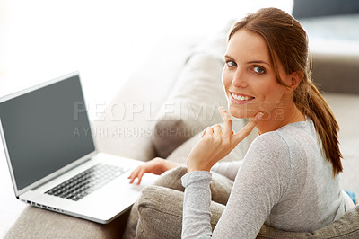 Buy stock photo Happy woman sitting on couch with a laptop