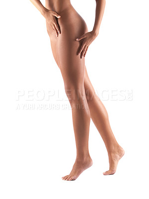 Buy stock photo Cropped view of a woman's naked legs and buttocks - isolated
