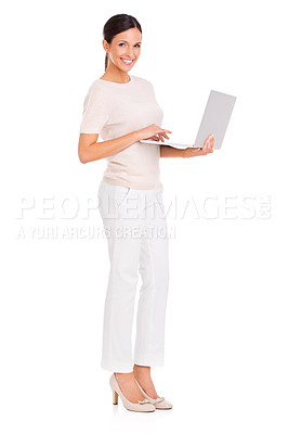 Buy stock photo Full-length studio portrait of an attractive young woman standing with a laptop