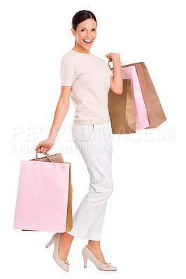 Buy stock photo Full-length portrait of an attractive young woman carrying many shopping bags