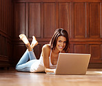 Happy young female working on laptop