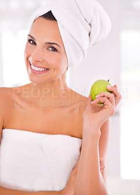 Buy stock photo A beautiful woman holding a green apple in her hand