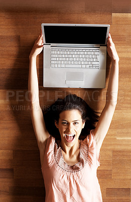 Buy stock photo Excited young woman holding her new laptop
