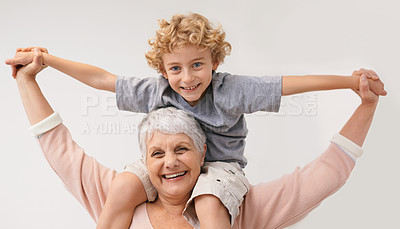 Buy stock photo Shot of a grandmother giving her grandson a piggback